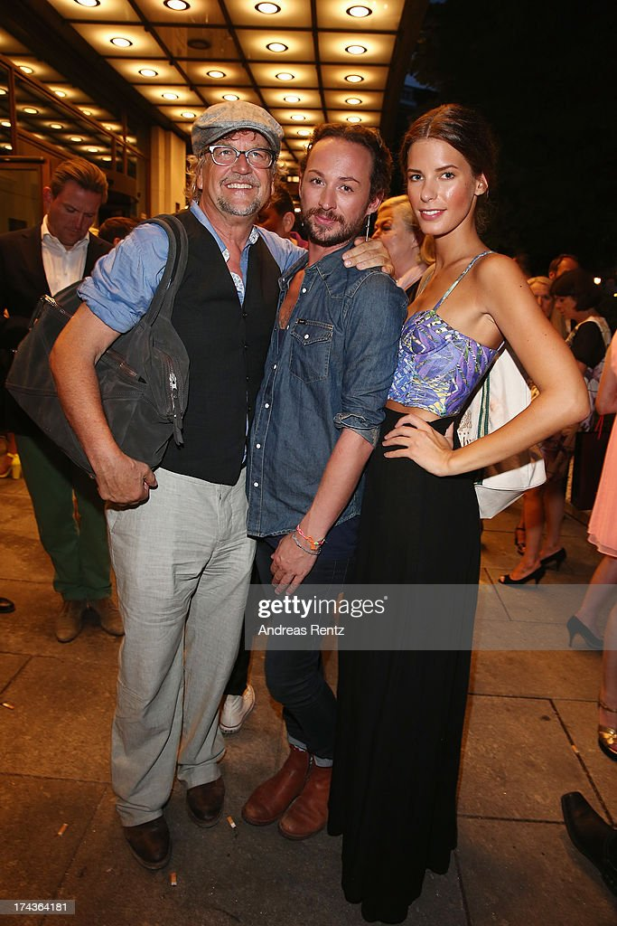 Martin Krug, designer Marcel Ostertag and Julia Trainer attend the Marcel Ostertag fashion show at Charles Hotel on July 24, 2013 in Munich, Germany.