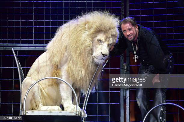 Martin Lacey jr performs with his lions during the Circus Krone Premiere at Circus Krone on December 25 2018 in Munich Germany