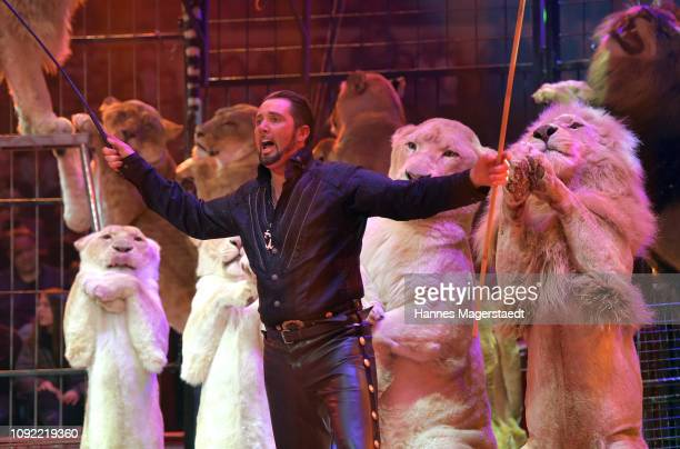 Martin Lacey Jr performs with his lions during the second show premiere of the winter season as part of the 100th anniversary celebrations at Circus...