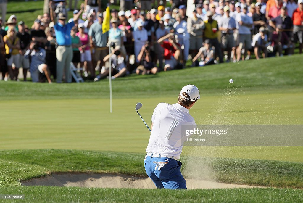 Martin Laird of Scotland hits a bunker shot to the eighth green during the final round of the Bob Hope Classic at the Palmer Private course at PGA West on January 23, 2011 in La Quinta, California.