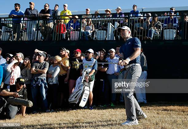 Martin Laird of Scotland plays a ball out of the rough on 17 during the fourth round of the Waste Management Phoenix Open at TPC Scottsdale on...