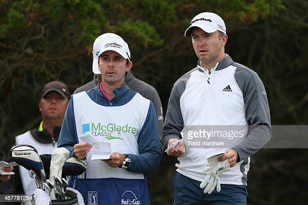 Martin Laird of Scotland talks to his caddie on the second tee box during the second round of The McGladrey Classic at Sea Island's Seaside Course on...