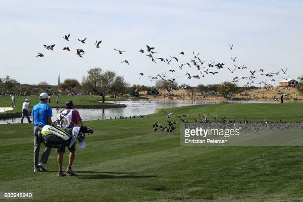 Martin Laird of Scotland walks down the 11th hole during the final round of the Waste Management Phoenix Open at TPC Scottsdale on February 5 2017 in...