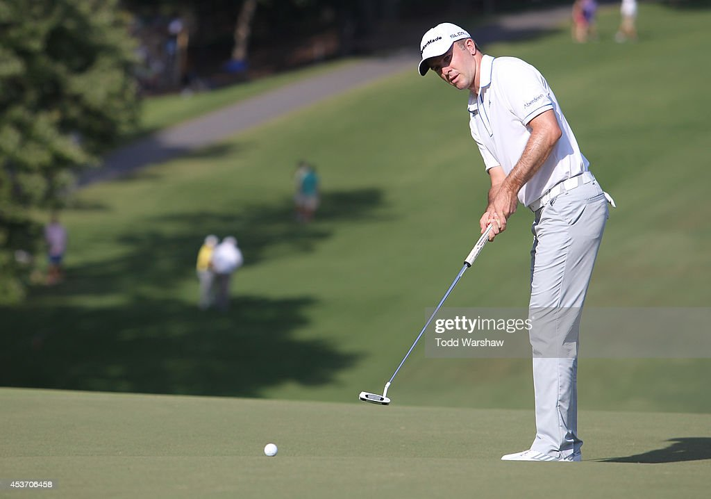 Martin Laird of Scottland putts on the 18th hole during the third round of the Wyndham Championship at Sedgefield Country Club on August 16, 2014 in Greensboro, North Carolina.