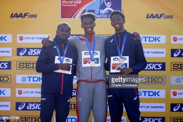 Martin Lamou of France Jordan ADiaz of Cuba and Jonathan Seremes of France celebrates with their medals during the medal ceremony for the men's...