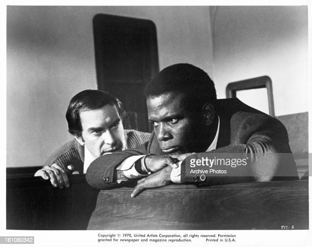 Martin Landau and Sidney Poitier in a scene from the film 'They Call Me Mister Tibbs' 1970