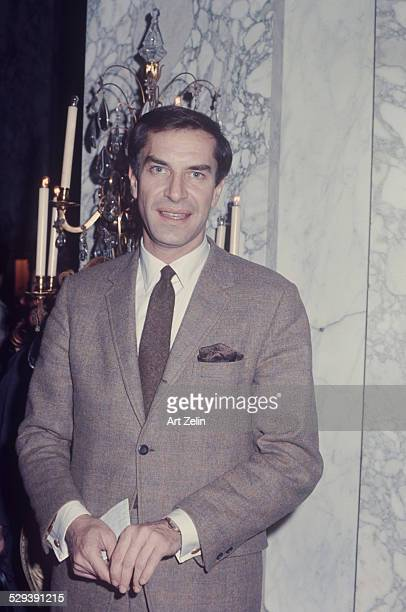 Martin Landau at the Plaza Hotel wearing a brown suit and tie circa 1970 New York