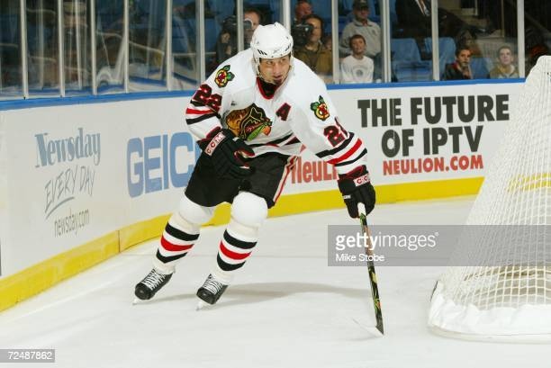 Martin Lapointe of the Chicago Blackhawks skates against the New York Islanders during the game on October 31, 2006 at Nassau Coliseum in Uniondale,...