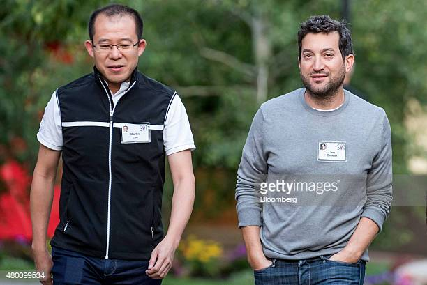 Martin Lau president of Tencent left and Jon Oringer founder of Shutterstock Inc arrive for a morning session during the Allen Co Media and...
