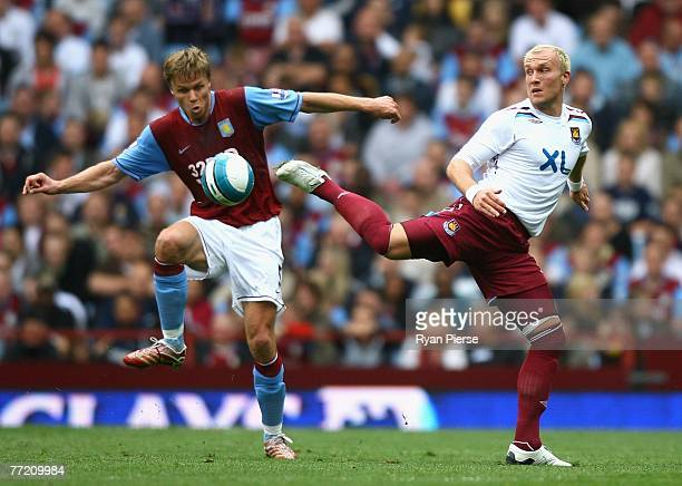 Martin Laursen of Aston Villa competes for the ball against Dean Ashton of West Ham during the Barclays Premier League match between Aston Villa and...
