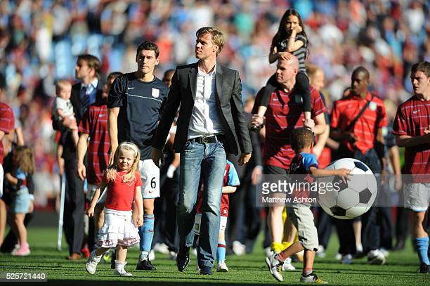 Martin Laursen of Aston Villa walks around the pitch to applaud the Villa fans after retiring from the game