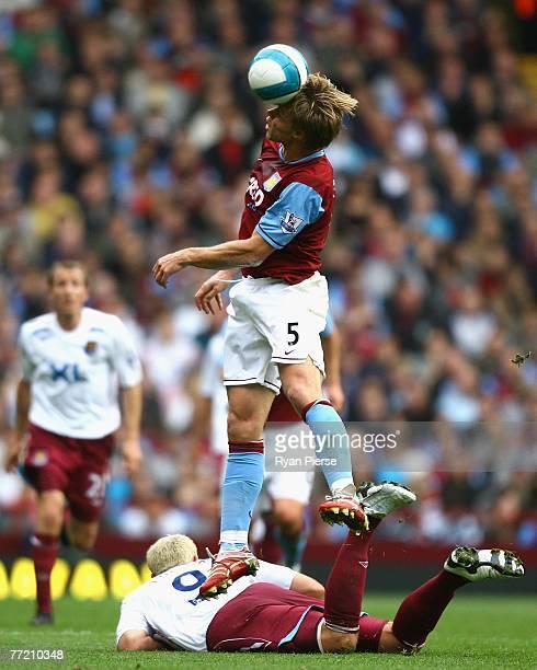 Martin Laursen of Aston Villa wins the ball over Dean Ashton of West Ham during the Barclays Premier League match between Aston Villa and West Ham...