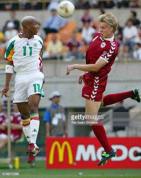 Martin Laursen of Denmark and El Hadji Diouf of Senegal compete for the ball during the FIFA World Cup Korea/Japan Group A match between Denmark and...