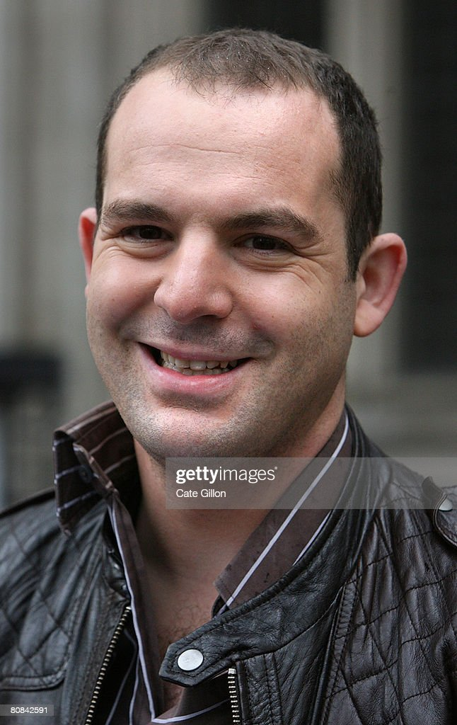 Martin Lewis of the website moneysavingexpert.com, smiles2 outside the High Court on April 24, 2008 in London, England. The money specialist reacted to UK's major banks losing a test case in the High Court over unfair bank charges.