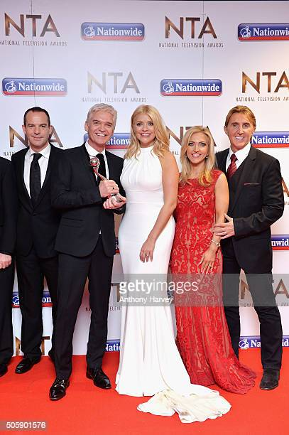 Martin Lewis Phillip Schofield Holly Willoughby Eva Speakman and Nik Speakman of 'This Morning' accept the award for Best Live Magazine at the 21st...