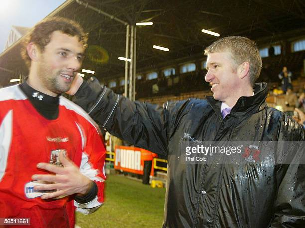 Martin Ling manager of Leyton Orient congratulates player Wayne Carlisle following victory in the FA Cup Third Round match between Fulham and Leyton...