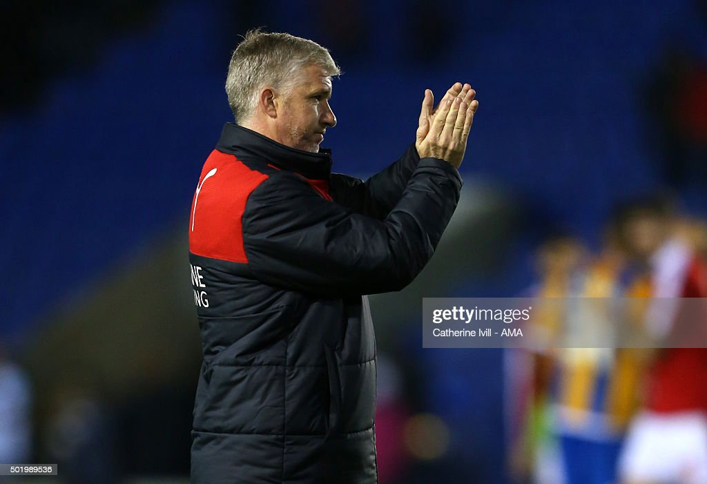 Martin Ling manager of Swindon Town applauds after the Sky Bet League One match between Shrewsbury Town and Swindon Town at New Meadow on December 19, 2015 in Shrewsbury, United Kingdom.