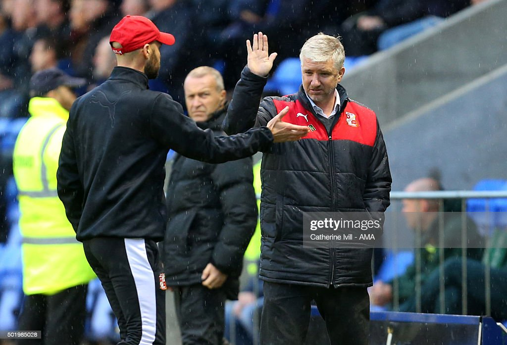 Martin Ling manager of Swindon Town celebrates with first team coach Luke Williams after Nicky Ajose of Swindon Town scores to make it 0-1 during the Sky Bet League One match between Shrewsbury Town and Swindon Town at New Meadow on December 19, 2015 in Shrewsbury, United Kingdom.