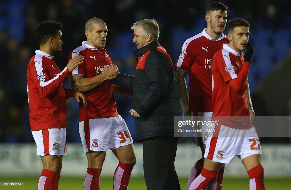 Martin Ling manager of Swindon Town congratulates his team after the Sky Bet League One match between Shrewsbury Town and Swindon Town at New Meadow on December 19, 2015 in Shrewsbury, United Kingdom.