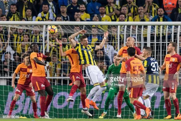 Martin Linnes of Galatasaray SK Bafetimbi Gomis Sofiane Feghouli Sofiane Feghouli of Galatasaray SK Roman Neustädter of Fenerbahce SK goalkeeper...