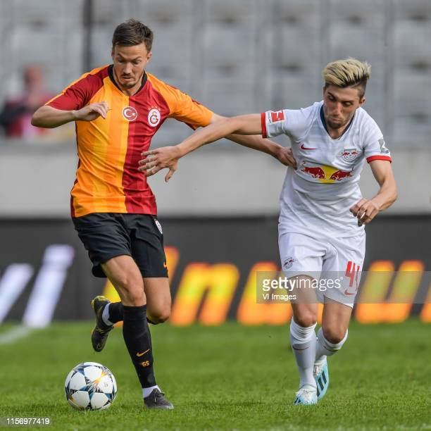 Martin Linnes of Galatasaray SK Kevin Kampl of Red Bull Leipzig during the Preseason Friendly match between Red Bull Leipzig v Galatasaray SK at...
