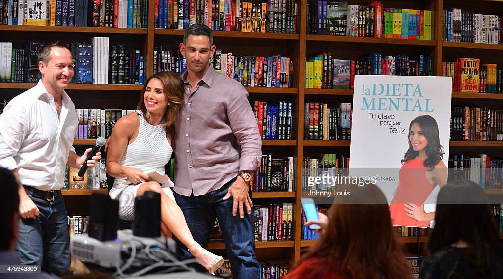 Martin Llorens, Laura Posada and husband Jorge Posada greets fans and signs copies of her book 'La dieta mental' at Books and Books-Gables on June 4, 2015 in Coral Gables, Florida.