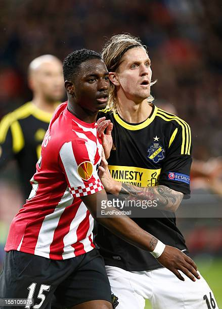 Martin Lorentzon of AIK challenges Jetro Willems of PSV Eindhoven during the UEFA Europa League group stage match between PSV Eindhoven and AIK held...