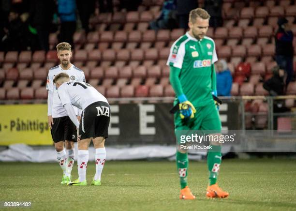 Martin Lorentzson & Michael Almeback & Oscar Jansson of Orebro SK is dejected during the Allsvenskan match between Orebro SK and Halmstad BK at Behrn...
