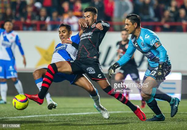 Martin Lucero of Tijuana and Hugo Rodriguez of Puebla fight for the ball during the 4th round match between Tijuana and Puebla as part of the Torneo...