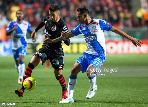 Martin Lucero of Tijuana fights for the ball with Hugo Rodriguez of Puebla during the 4th round match between Tijuana and Puebla as part of the...