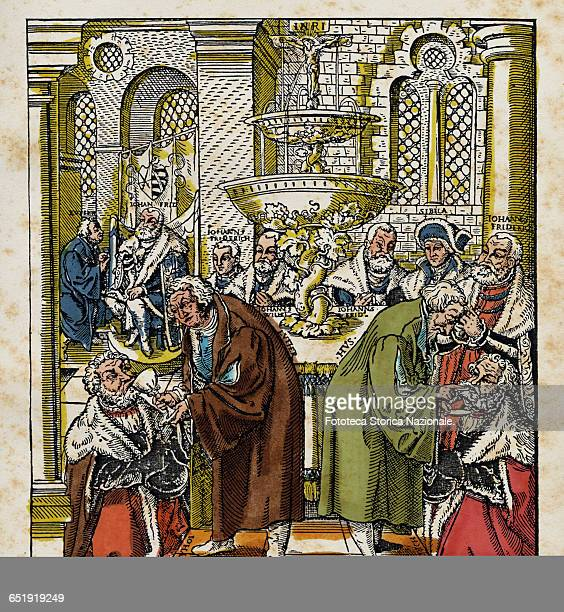 Martin Luther and Jan Hus symbolically represented together during a function serving the bread and the wine during Holy Communion Colored engraving...