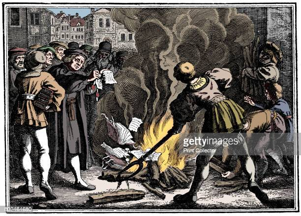 Martin Luther German Protestant reformer burning the Papal Bull excommunicating him Wittenberg 1520 Artist Unknown