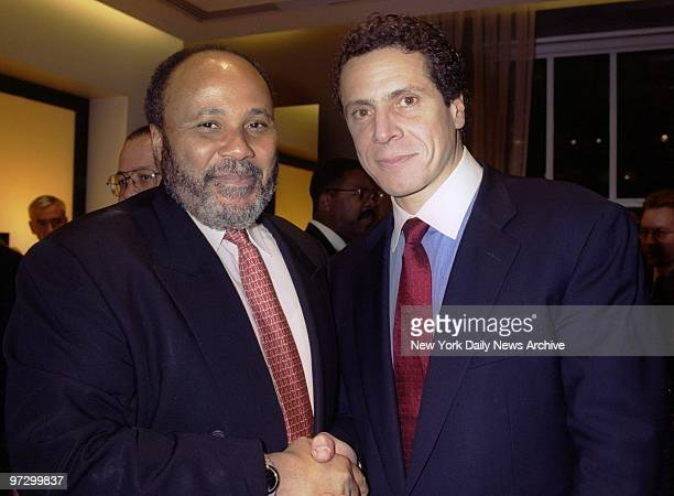 Martin Luther King 3rd and Andrew Cuomo shake hands at a party at the Kenneth Cole store on Fifth Ave where Cuomo housing and urban development...