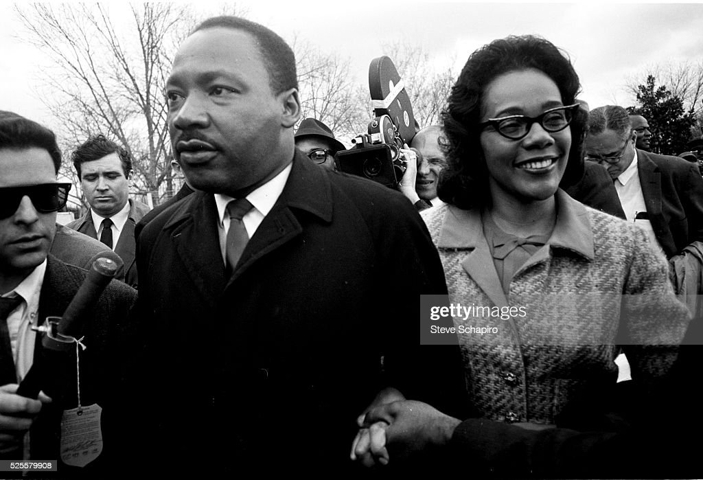 Martin Luther King holds hands with his wife Coretta Scott King as they embark on their 5-day march from Selma to Montgomery.