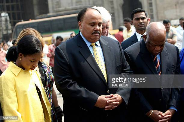 Martin Luther King III along with his wife Arndrea Waters King and Congressman John Lewis stand in silence in remeberence of his father Martin Luther...