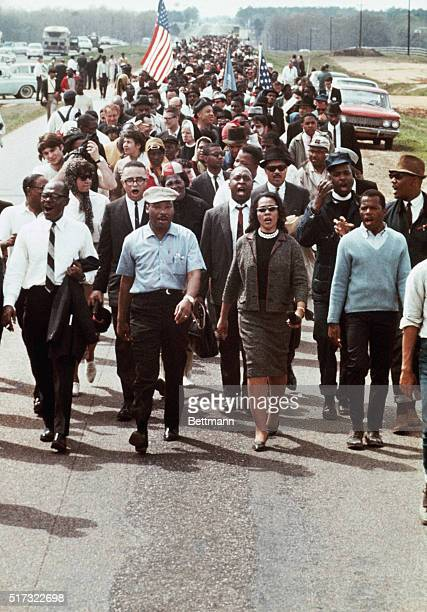 Martin Luther King Jr and his wife Coretta lead a fiveday march to the Alabama State Capitol in Montgomery in 1965