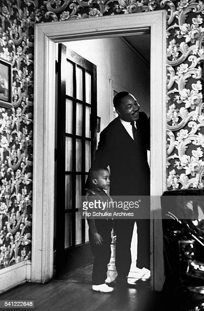 Martin Luther King Jr and his young son Dexter stand in a doorway of their Atlanta home