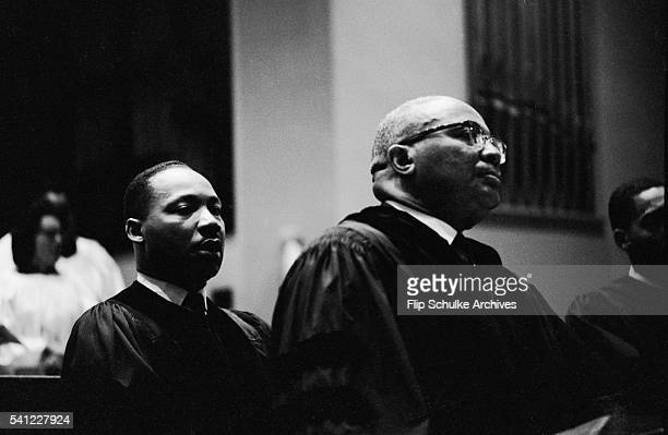 Martin Luther King Jr behind his father Reverend Martin Luther King Sr before delivering a sermon at Ebenezer Baptist Church
