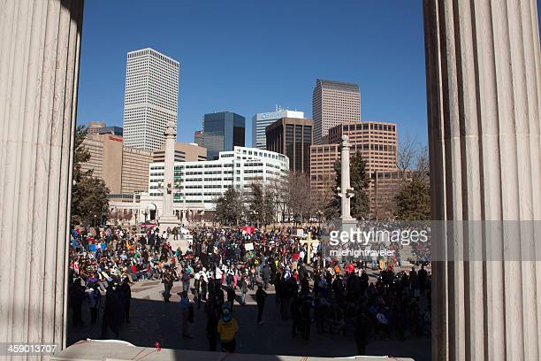 martin luther king jr. day march arrives in denver - martin luther king jr day parade stock pictures, royalty-free photos & images