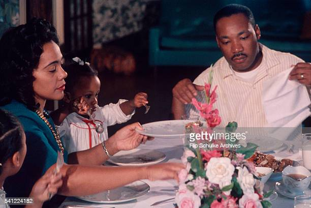 Martin Luther King Jr enjoys Sunday dinner with his wife Coretta and daughters Yolanda and Bernice