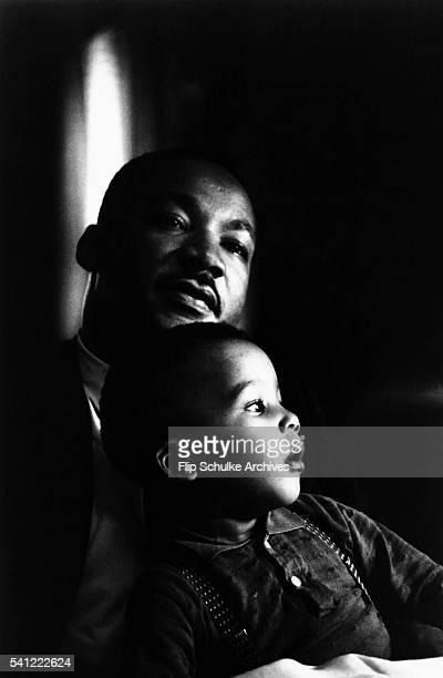 Martin Luther King Jr holds his young son Dexter on his lap at home in Atlanta That day King was informed that he would receive the 1964 Nobel Prize...