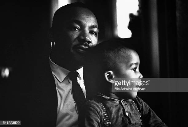 Martin Luther King Jr holds his young son Dexter on his lap at home in Atlanta