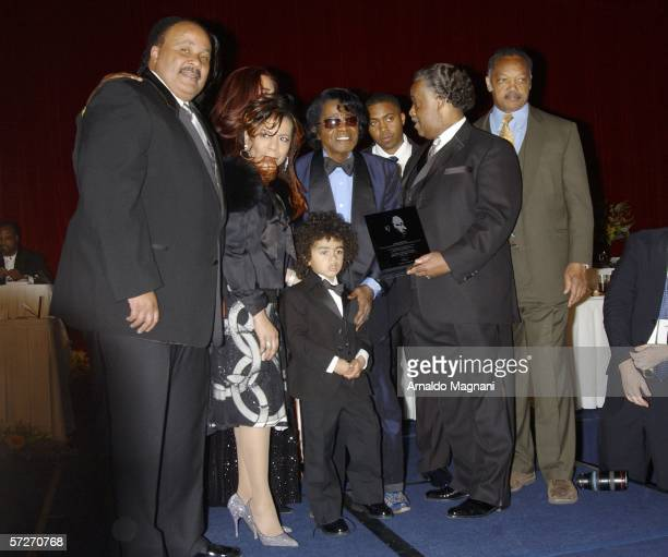 Martin Luther King Jr III songwriter Valerie Simpson singer James Brown his son James Brown II Reverend Al Sharpton and Reverend Jesse Jackson stand...