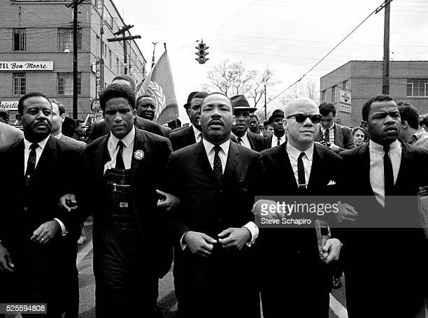 Martin Luther King Jr leading march from Selma to Montgomery to protest lack of voting rights for African Americans Beside King is John Lewis...