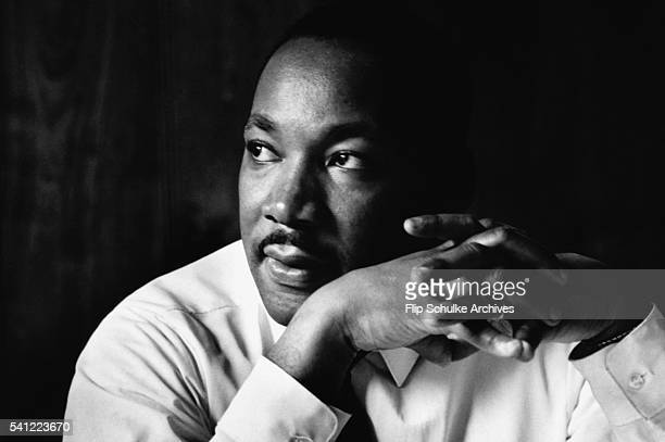 Martin Luther King Jr listens at a meeting of the SCLC the Southern Christian Leadership Conference at a restaurant in Atlanta The SCLC is a civil...