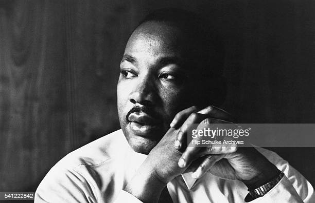 Martin Luther King Jr listens to other staff members of SCLC during a meeting at an Atlanta restaurant