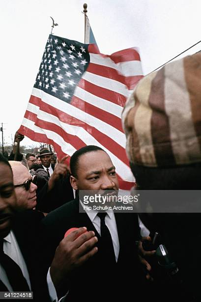 Martin Luther King Jr marches with other religious leaders and activists past Browns Chapel in Selma Alabama during the second attempted march to...