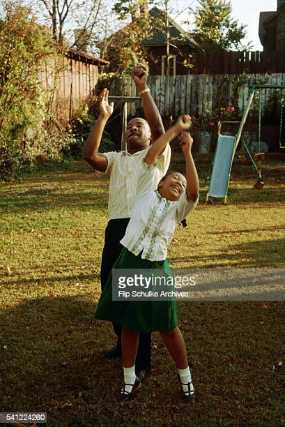 Martin Luther King Jr plays catch with his daughter Yolanda in their backyard