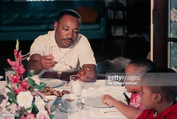 Martin Luther King Jr serves pieces of chicken to his young sons Marty and Dexter at Sunday dinner