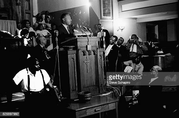 Martin Luther King Jr speaking from the pulpit of a Birmingham church